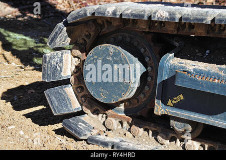 close-up of the crawler track of an excavator at construction site - Stock Photo