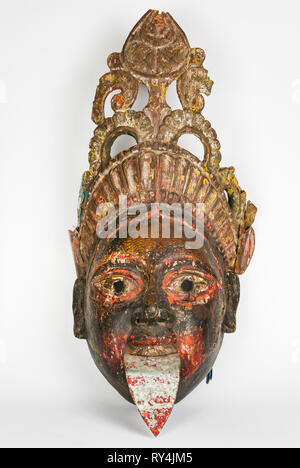 Ancient and beautiful mask depicting the Goddess Kali. Dating from the 50s. Isolated on a white background. - Stock Photo