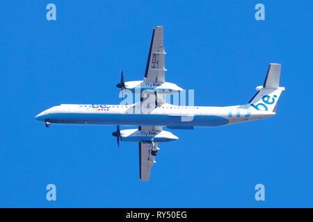 Flybe De Havilland Bombardier DHC-8 on final approach into Leeds Bradford International Airport. - Stock Photo