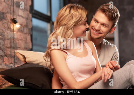 Lovely just married couple enjoying time together in the bedroom - Stock Photo