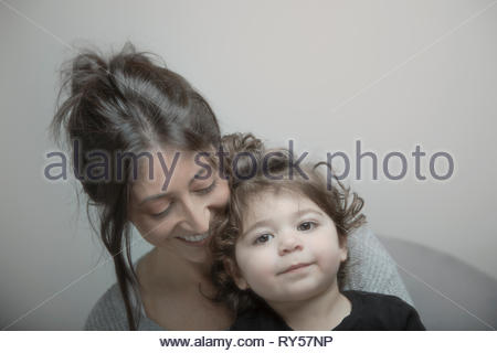 Portrait cute Latina toddler girl with mother - Stock Photo