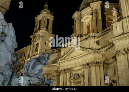 Piazza Navona Square, Bernini's 4 Rivers Fountain in front of Borromini's Saint Agnese in Agone church. By night. Rome, Italy, Europe. - Stock Photo