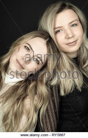 Portrait confident beautiful young blonde women - Stock Photo