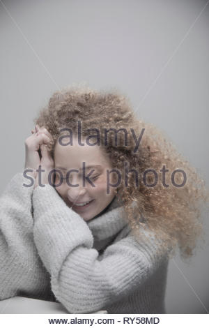 Portrait beautiful young woman with long curly blonde hair - Stock Photo
