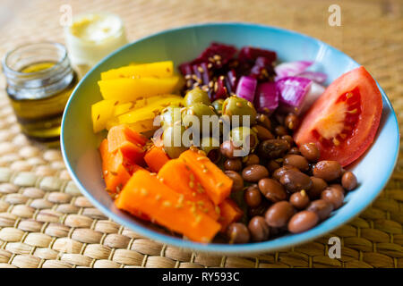 A vibrant vegan buddha bowl filled with colourful vegetables and pulses. Veganism - Stock Photo