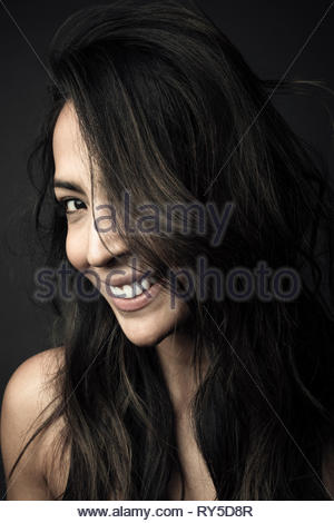 Portrait confident beautiful Latina woman with long black hair - Stock Photo
