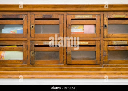 Beautiful old wood mailboxes in an apartment lobby in Florence, Italy - Stock Photo