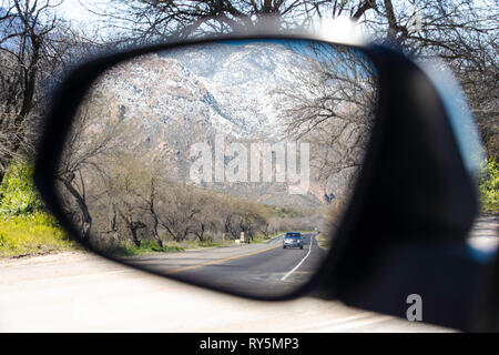 Scenic reflections in a side view mirror from inside a car. Catalina State Park, Tucson, Arizona - Stock Photo