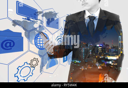 Double exposure of a businessman and a city using smartphone. Flip effect people. Technology effect.