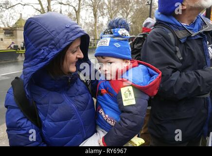 London, UK. 12th Mar, 2019. Pro and Anti Brexit protesters continue to gather outside Parliament on Meaningful Vote Day. Credit: Brian Minkoff /Alamy Live News - Stock Photo