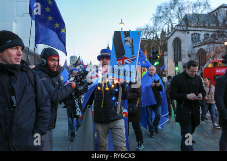 London, UK. 12th Mar, 2019. Pro Brexit and Pro Remain groups around Parliament Sq and Westminster as politicians vote on the UK's withdrawal from the European Union. Penelope Barritt/Alamy Live News - Stock Photo