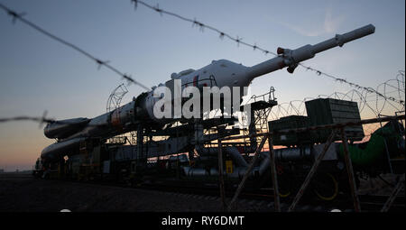 Baikonur, Kazakhstan. 12th Mar, 2019. The Russian Soyuz MS-12 rocket is transported by train to the launch pad at the Baikonur Cosmodrome March 12, 2019 in Baikonur, Kazakhstan. The Expedition 59 crew: Nick Hague and Christina Koch of NASA and Alexey Ovchinin of Roscosmos will launch March 14th for a six-and-a-half month mission on the International Space Station. Credit: Planetpix/Alamy Live News - Stock Photo
