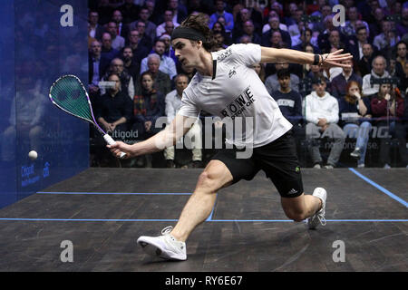 London, UK. 12th Mar, 2019. Paul Coll of New Zealand in action against Tom Richards of England. Citigold Canary Wharf Squash Classic, day 3, round 2 at the East Wintergarden in Canary Wharf , London on Tuesday 12th March 2019.   pic by  Steffan Bowen/Andrew Orchard sports photography/Alamy Live news - Stock Photo