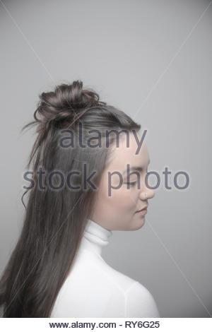 Portrait serene beautiful brunette young woman - Stock Photo