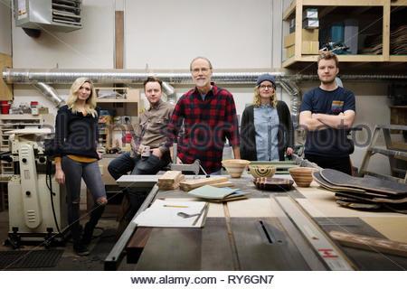 Portrait confident artists in workshop - Stock Photo