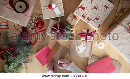 View from above woman wrapping christmas gifts - Stock Photo