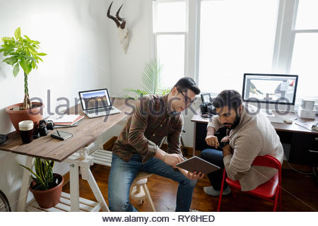 Creative businessmen using laptop in home office - Stock Photo