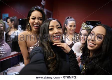 Selfie point of view women friends in nightclub bathroom - Stock Photo
