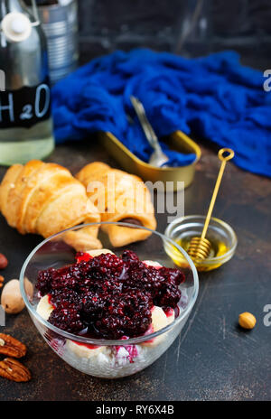 chia desert with blackberry jam and nuts - Stock Photo