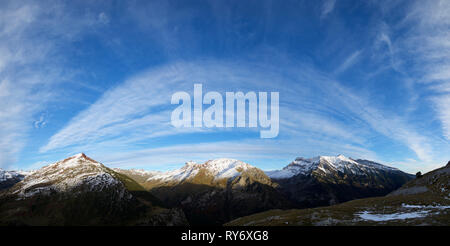 Scenic view Of snowcapped mountain range against blue sky - Stock Photo