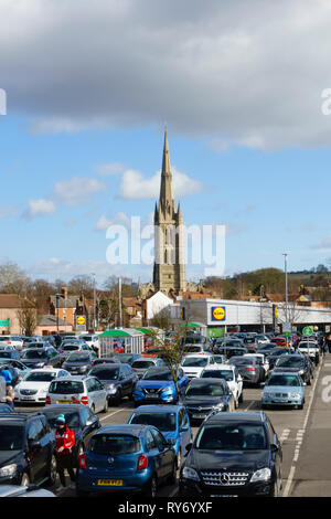 ASDA supermarket car park, with St Wulfrums church and Lidl store. Grantham, Lincolnshire, England - Stock Photo
