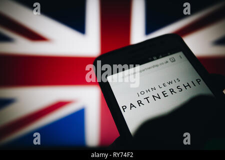 John Lewis Partnership (JLP), an employee owned UK company. Logo on its website is seen on a smartphone display - Stock Photo