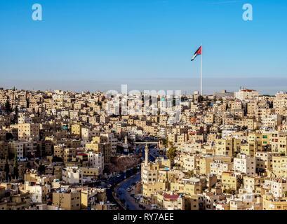 Cityscape with Raghadan Flagpole seen from Citadel Hill, Amman, Amman Governorate, Jordan - Stock Photo