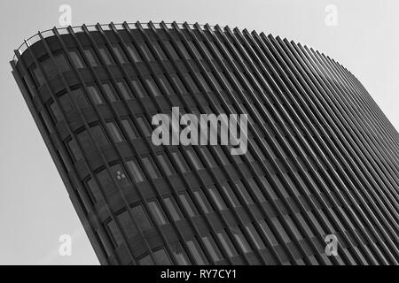 Berlin, Germany, September 30, 2018. The building of Ernst Young GmbH is an auditing company. Business center, high-rise office building in modern cit - Stock Photo