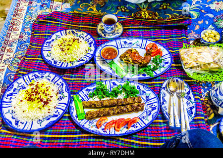 Iranian Beef Lamb Koobideh with Rice Cutlery and Tea on a Blanket - Stock Photo