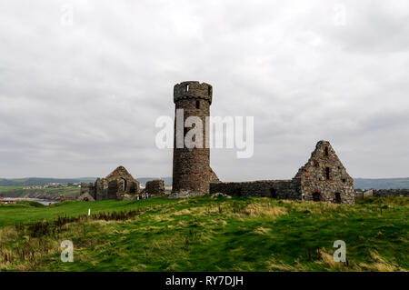 The ruins of St. German Cathedral within Peel castle on St Patrick's Isle connected by a causeway in Peel on the west coast of the Isle of Man, Britai - Stock Photo