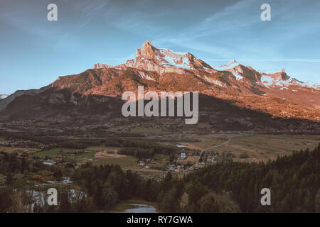 Tête du Colonney, big mountain range in French alps, aerial, drone shot from a distant village of Domancy, France - Stock Photo