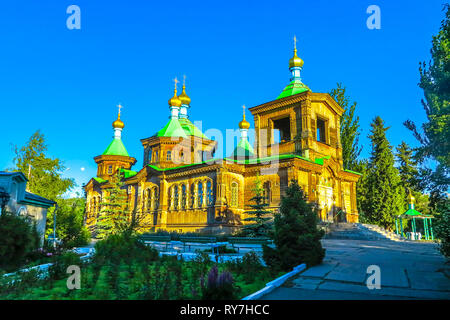 Karakol Holy Trinity Wooden Architecture Russian Orthodox Cathedral at Sunset - Stock Photo