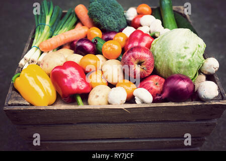 a vintage wooden crate filled with colourful fresh fruit and