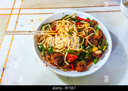 Uyghur Traditional Spicy Lagman Noodles Dish with Mutton Chunks and Vegetables - Stock Photo