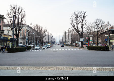 BERGAMO, ITALY - FEBRUARY 20, 2019: panoramic view of street Viale Papa Giovanni XXIII with people and cars from railroad station in Lower Town of Ber - Stock Photo