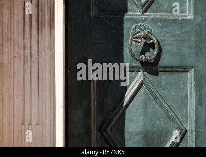 An old green door and door knocker in the old town on a sunny summer's day, Dubrovnik, Croatia - Stock Photo
