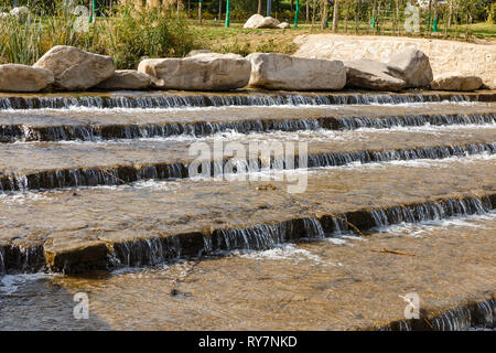 decorative waterfall of natural stone in the form of steps. - Stock Photo