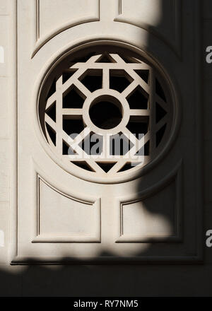 Semi-abstract view of an ornate window in the old town with a shadow on the wall, Dubrovnik, Croatia - Stock Photo