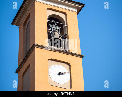 Travel to Italy - detail of bell tower of church Chiesa di Santa Marta in Lecco city, Lombardy - Stock Photo