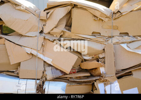 Waste paper from boxes and cardboard, the fee for recycling - Stock Photo