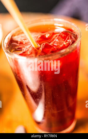 A tall, cool, glass of hibiscus tea. - Stock Photo