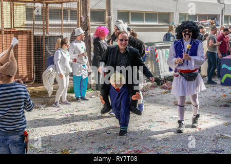 Carnival parade figure of President Trump. US President Donald Trump depicted as walking carrying a man on his shoulders in Xanthi, Greece. - Stock Photo
