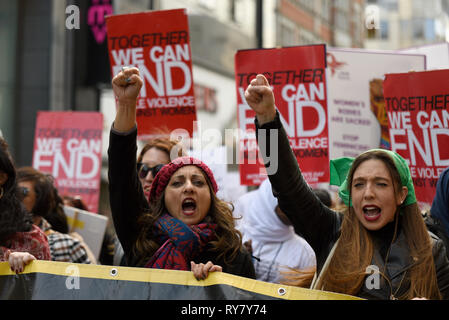 Million Women Rise protest march. Thousands of women and children marched through London to raise awareness of violence towards women - Stock Photo