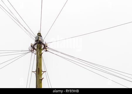 Small utility pole in the country field - Stock Photo