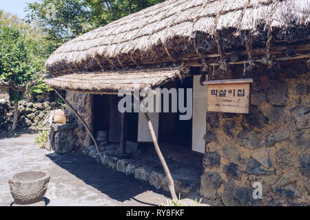 Jeju island, South Korea, september 09, 2015: old traditional korean cottage in folk village museum - Stock Photo