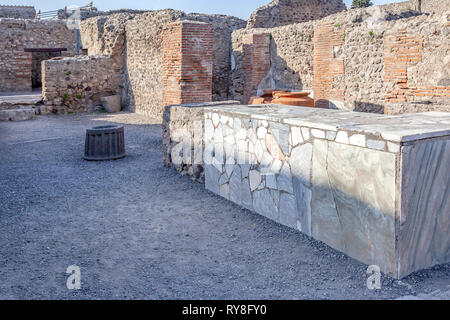 Pompeii is an ancient Roman city near Naples, in the Campania region, buried under a layer of volcanic ash as a result of the eruption of Vesuvius in  - Stock Photo
