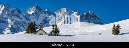 Col du Lautaret, Hautes-Alpes, Ecrins National Park, Alps, France: Panoramic winter view with La Chappelle des Fusillés - Stock Photo