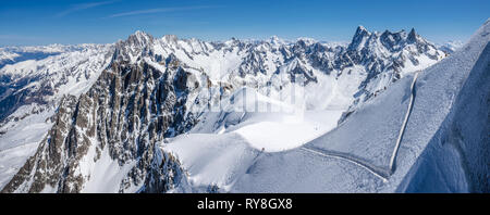 Mont-Blanc Mountain Range, Chamonix, Hautes-Savoie, Alps, France: Winter View from Aiguille du Midi near the Vallee Blanche ski resort - Stock Photo