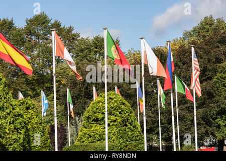 Assorted colourful national Flags on white flag poles,York,North Yorkshire,England,UK. - Stock Photo