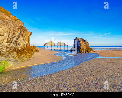 Rocks on Holywell Beach, with a view through  to Carters Rocks, North Cornwall, UK - Stock Photo